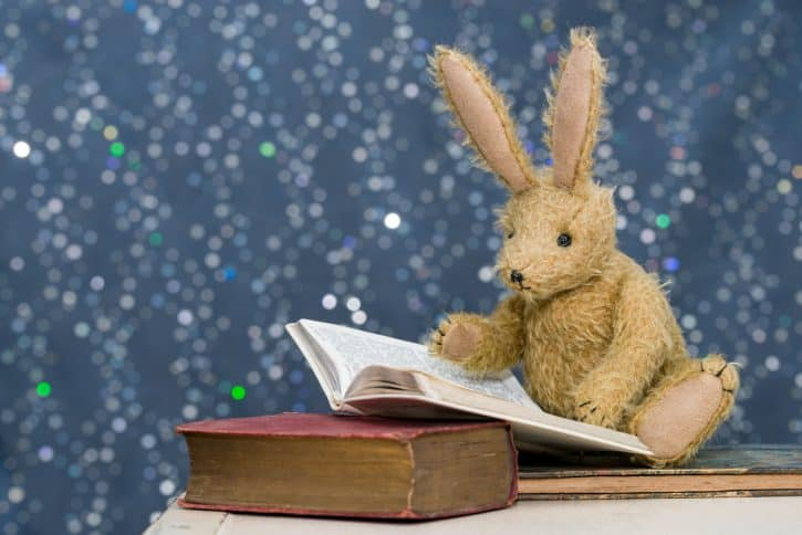 Stuffed bunny reading a book